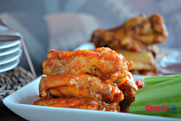 Enjoy these finger lickin' good Easy Tailgate Party Buffalo Wings on your next BIG game get-together. They are tasty, juicy, and the perfect tailgate party must-have. Get the recipe at CleverlyMe.com