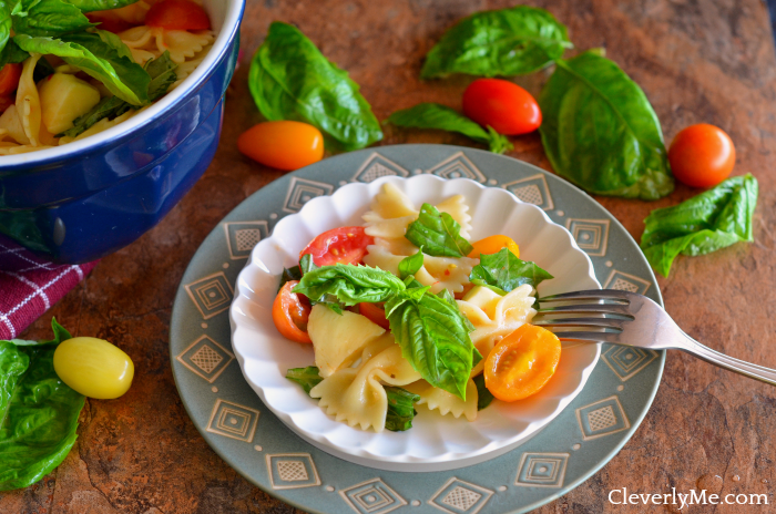Our favorite Caprese Pasta Salad recipe uses delicious in-season tomatoes, fresh mozzarella cheese and topped with fresh basil and Italian dressing. More at CleverlyMe.com